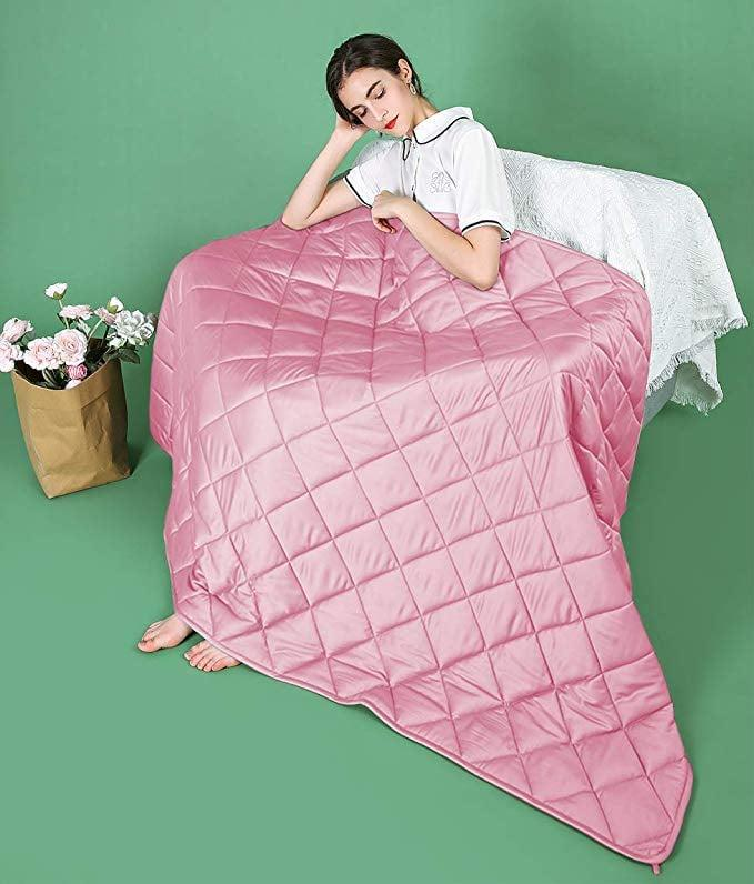 """<p>We want a pink weighted blanket, and this <a href=""""https://www.popsugar.com/buy/ZZZhen-Weighted-Blanket-508843?p_name=ZZZhen%20Weighted%20Blanket&retailer=amazon.com&pid=508843&price=58&evar1=casa%3Aus&evar9=46827963&evar98=https%3A%2F%2Fwww.popsugar.com%2Fhome%2Fphoto-gallery%2F46827963%2Fimage%2F46827976%2FZZZhen-Weighted-Blanket&list1=shopping%2Camazon%2Chome%20decor%2Cwinter&prop13=mobile&pdata=1"""" rel=""""nofollow"""" data-shoppable-link=""""1"""" target=""""_blank"""" class=""""ga-track"""" data-ga-category=""""Related"""" data-ga-label=""""https://www.amazon.com/ZZZhen-Weighted-Blanket-Consturction-Year-round/dp/B07TGKZ9LG/ref=sr_1_10?keywords=top%2Brated%2Bblankets&amp;qid=1572449127&amp;sr=8-10&amp;th=1"""" data-ga-action=""""In-Line Links"""">ZZZhen Weighted Blanket</a> ($58) makes our dreams come true.</p>"""