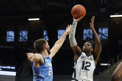 Butler's Myles Tate (12) shoots over Creighton's Mitch Ballock (24) during overtime of an NCAA college basketball game, Saturday, Jan. 16, 2021, in Indianapolis. Butler won 70-66. (AP Photo/Darron Cummings)