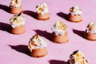 """These campfire-inspired treats combine rich chocolate, graham crackers, and marshmallows in a whole new way. <a href=""""https://www.epicurious.com/recipes/food/views/frozen-mini-smores-pies?mbid=synd_yahoo_rss"""" rel=""""nofollow noopener"""" target=""""_blank"""" data-ylk=""""slk:See recipe."""" class=""""link rapid-noclick-resp"""">See recipe.</a>"""