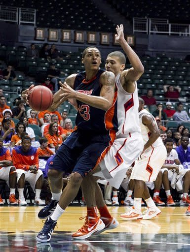 UTEP forward Gabriel McCulley goes to the basket past Clemson center Milton Jennings during the first half of an NCAA college basketball game at the Stan Sheriff Center Thursday, Dec. 22, 2011 in Honolulu. (AP Photo/Marco Garcia)