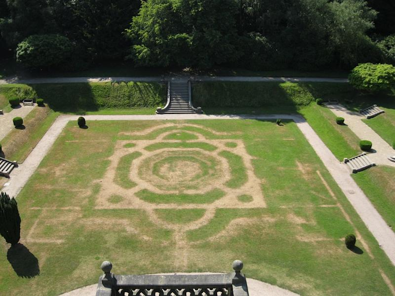 Crop marks show of the old garden at Gawthorpe Hall, Lancashire which was taken out in the 1940's but can now be seen again through the parched grass (SWNS)