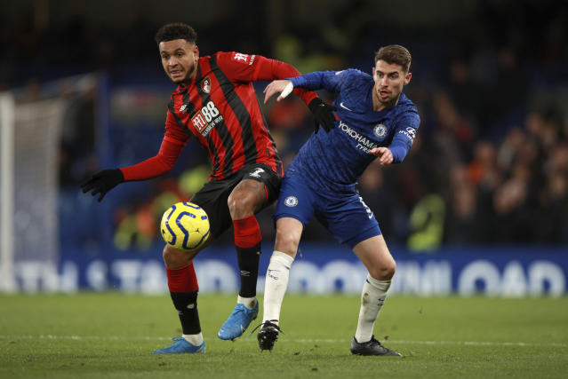 Bournemouth's Joshua King, left, duels for the ball with Chelsea's Jorginho during the English Premier League soccer match between Chelsea and Bournemouth, at Stamford Bridge in London, Saturday, Dec. 14, 2019. (AP Photo/Ian Walton)