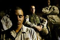 """<p>Paratroopers in the 1-504th regiment of the 82nd Airborne Division, nicknamed the """"Red Devils"""" pray before an overnight raid November 25, 2003 at Camp Mercury near Fallujah, Iraq. The overnight raid netted two men suspected of militant activities against American forces. (Photo by Chris Hondros/Getty Images) </p>"""