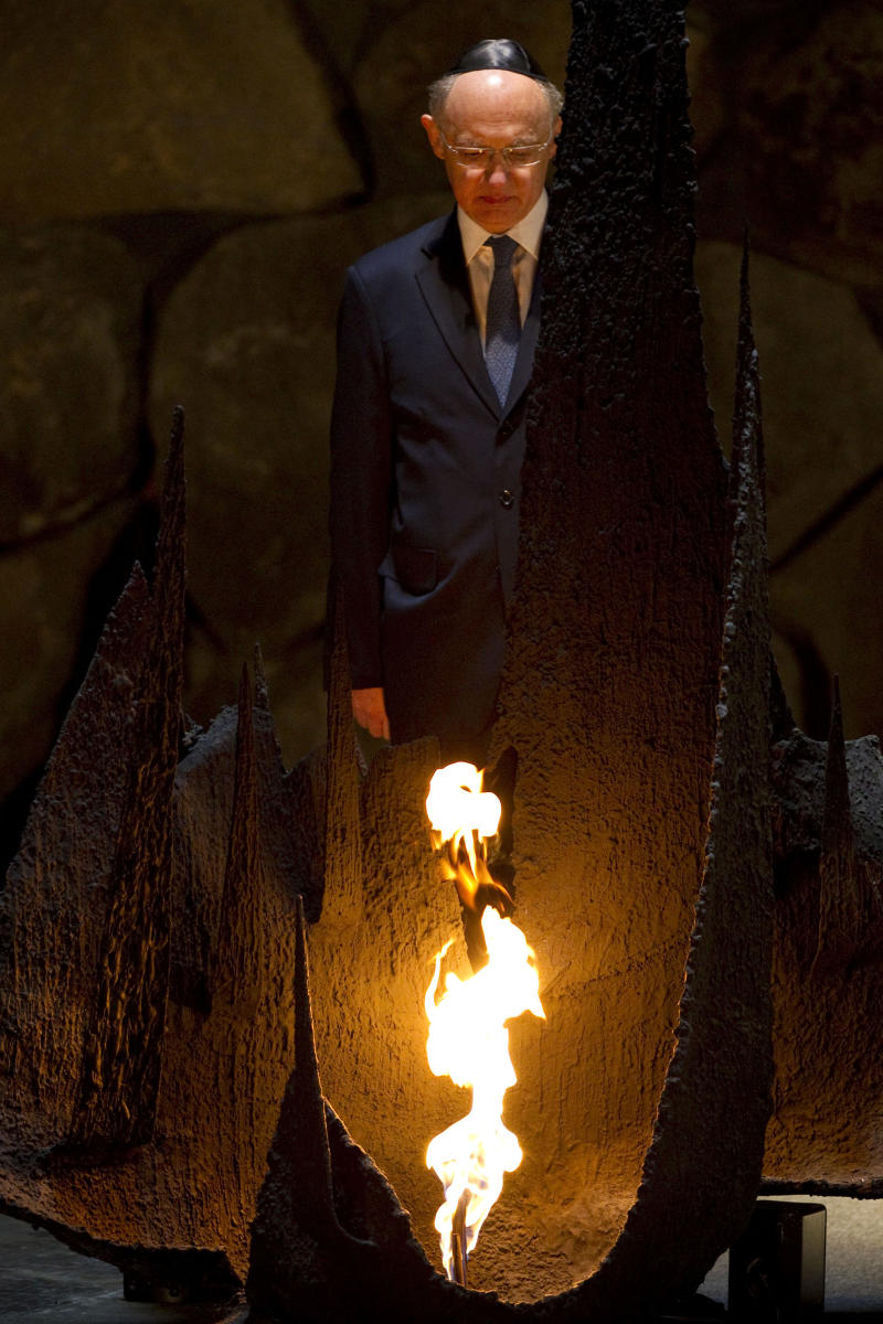 Argentina's Foreign Minister Hector Timerman rekindles the Eternal Flame at the Hall of Remembrance at the Yad Vashem Holocaust memorial, in Jerusalem, Monday, April 4, 2011. Timerman is on an official visit to the region. (AP Photo/Bernat Armangue)