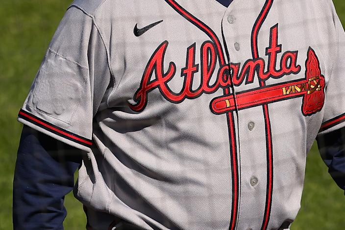 PHILADELPHIA, PA - APRIL 04: The All-Star Game logo is covered up on the right sleeve of manager Brian Snitker #43 of the Atlanta Braves during a baseball game against the Philadelphia Phillies at Citizens Bank Park on April 4, 2021 in Philadelphia, Pennsylvania. Atlanta was scheduled to be the host city of this year's All-Star Game, but MLB Commissioner Rob Manfred announced that due to Georgia's new voting laws, the league would be moving the game elsewhere. (Photo by Rich Schultz/Getty Images)
