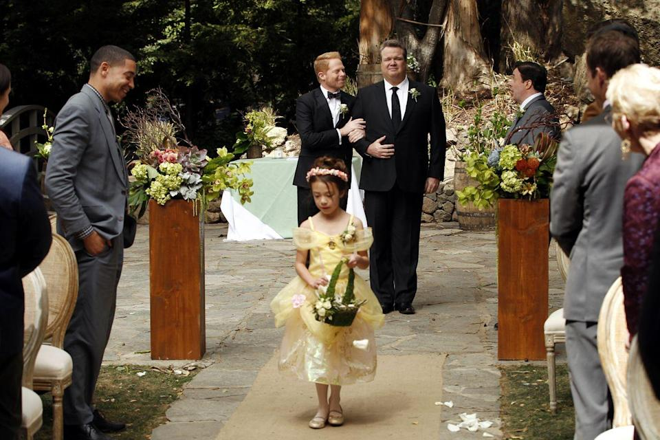 """<p><em>Modern Family</em>, which at the time was TV's <a href=""""https://www.thedailybeast.com/modern-familys-big-gay-and-important-wedding"""" rel=""""nofollow noopener"""" target=""""_blank"""" data-ylk=""""slk:most awarded and second-most nominated show in history"""" class=""""link rapid-noclick-resp"""">most awarded and second-most nominated show in history</a>, aired a season finale that fans had been long-awaiting—Mitch and Cam's wedding. One year before marriage equality was legalized across the country, 10.2 million viewers tuned in to watch the episode. </p>"""
