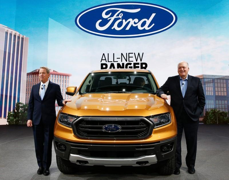 Bill Ford, executive chairman of the Ford Motor Company and Jim Hackett (R), President and CEO, present the 2019 Ford Ranger during the Ford press preview at the North American International Auto Show in Detroit,