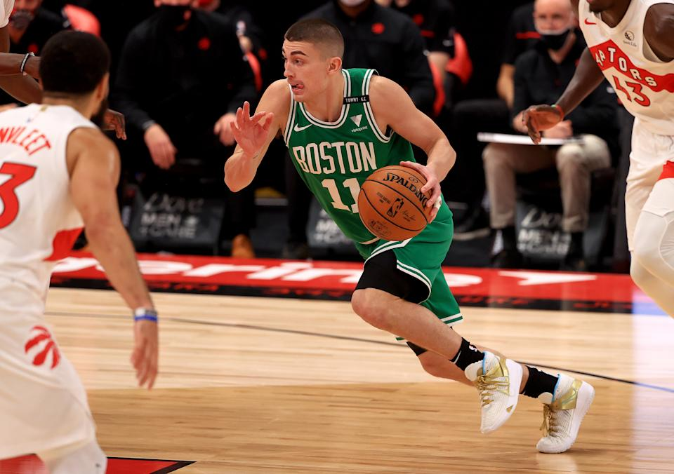 Payton Pritchard #11 of the Boston Celtics drives during a game against the Toronto Raptors at Amalie Arena on January 04, 2021 in Tampa, Florida.