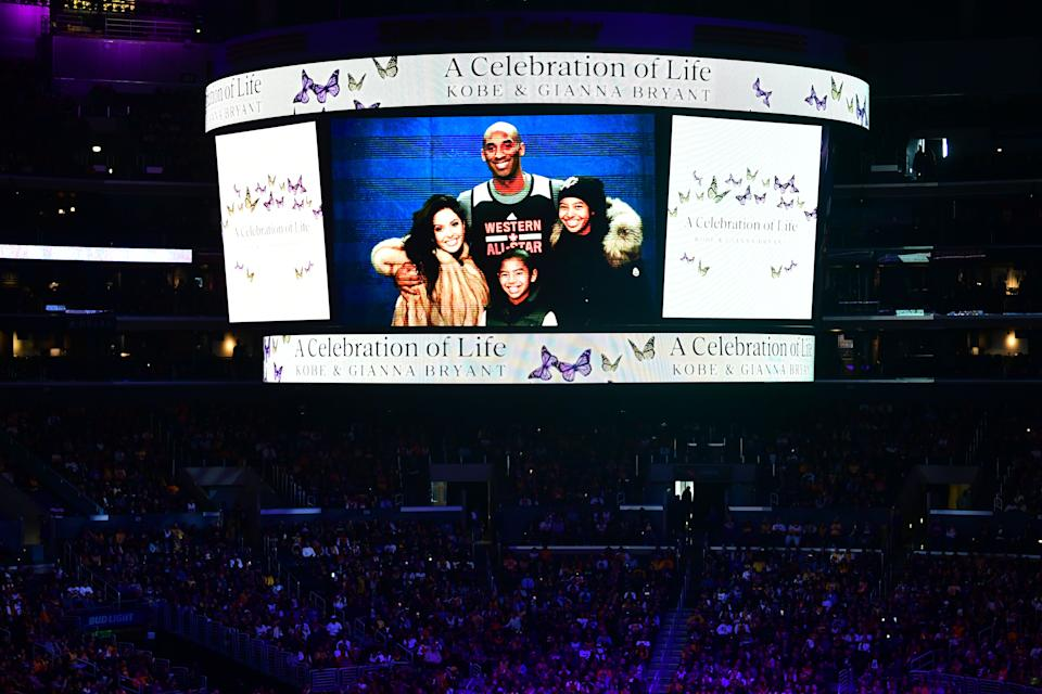 "A screen shows photos during the ""Celebration of Life for Kobe and Gianna Bryant"" service at Staples Center in Downtown Los Angeles on February 24, 2020. - Kobe Bryant, 41, and 13-year-old Gianna were among nine people killed in a helicopter crash in the rugged hills west of Los Angeles on January 26. (Photo by Frederic J. BROWN / AFP) (Photo by FREDERIC J. BROWN/AFP via Getty Images)"