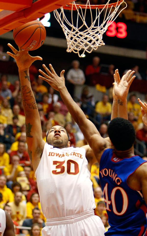 Iowa State forward Royce White (30) shoots over Kansas forward Kevin Young (40) during the first half of an NCAA college basketball game, Saturday, Jan. 28, 2012, in Ames, Iowa.  White scored 18 points as Iowa State won 72-64.