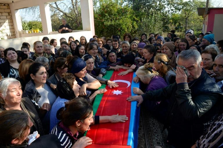 People in southern Azerbaijan were seen lamenting a coffin said to contain a soldier killed in the fighting
