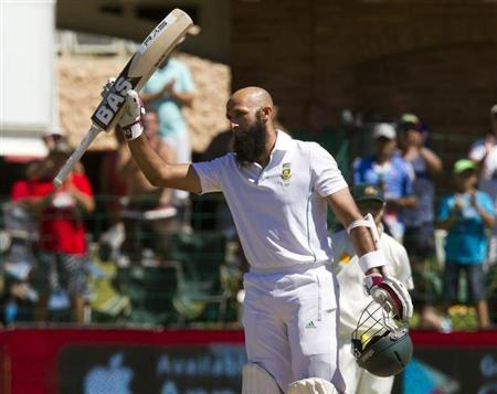 South Africa's Amla celebrates scoring a century during the fourth day of the second cricket test match against Australia in Port Elizabeth