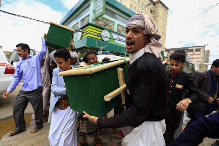 Mourners in the capital Sanaa carry the coffins of Yemenis reportedly killed during a coalition air strike (AFP Photo/Mohammed HUWAIS)