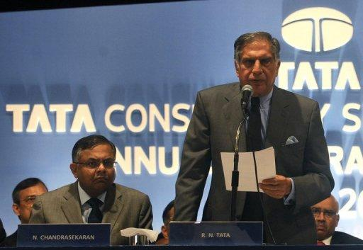 Chairman of Tata Consultancy Services, Ratan Tata (R) speaks during the annual general meeting of TCS in Mumbai