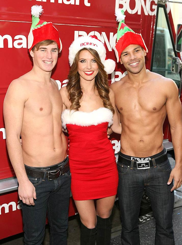 """Former """"Hills"""" hottie Audrina Patridge donned a festive ensemble, including a Santa hat, a Santa-inspired dress, and knee-high boots, as she posed with shirtless guys at the Hollywood and Highland Center in L.A. on Tuesday. It was part of a holiday event to promote Bongo jeans, in which spokeswoman Audrina handed out cupcakes, signed autographs, and met with fans. (12/6/2011)"""