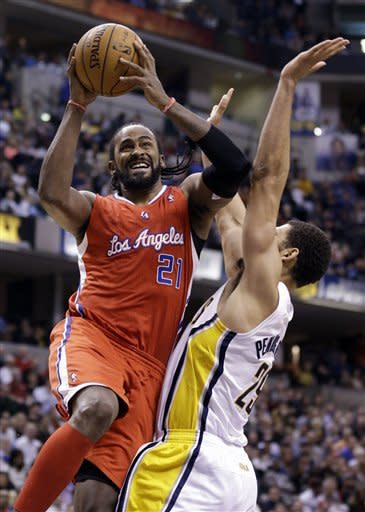 Los Angeles Clippers center Ronny Turiaf, left, shoots over Indiana Pacers forward Jeff Pendergraph during the first half of an NBA basketball game in Indianapolis, Thursday, Feb. 28, 2013. (AP Photo/Michael Conroy)