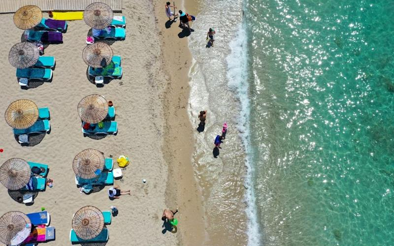 Social distancing yesterday on a beach in Izmir - getty