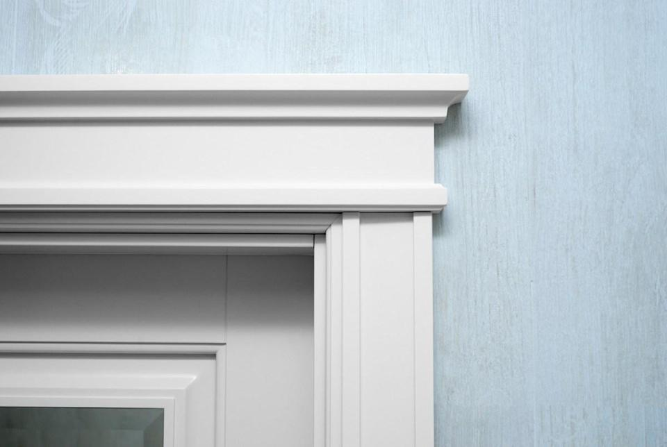 If you don't have the cash to install custom moldings, there's a hack to make it seem like you can: Use the pieces you can buy at a hardware store and a little caulk to make your moldings look like they were custom-made for your home. Filling in the gaps with caulk will allow them to expand and contract along with the changes in weather and will make those edges between pieces look seamless.