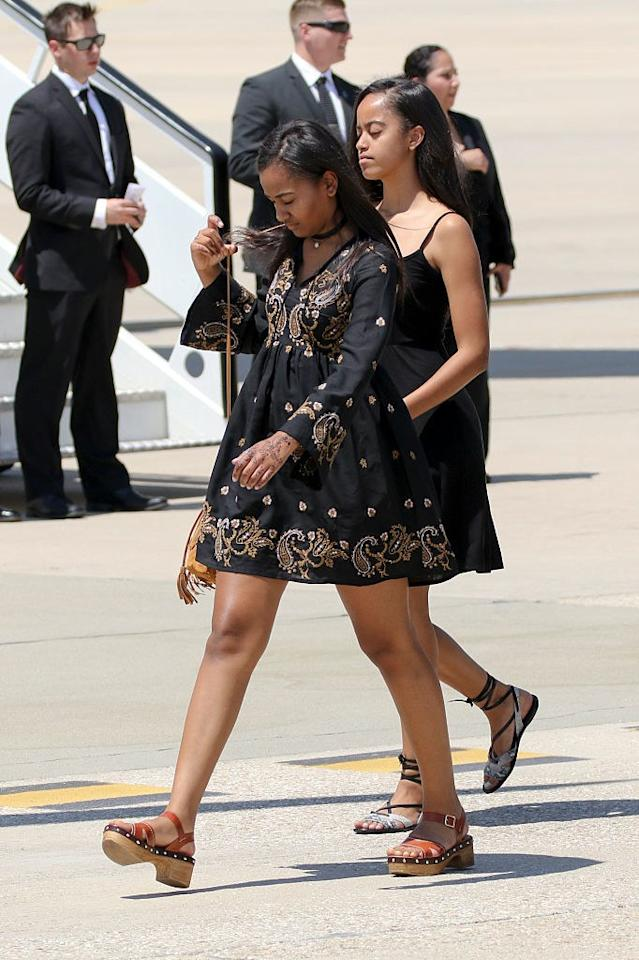 <p>Sasha wears a boho embroidered dress and clogs while in Spain for FLOTUS's Let Girls Learn event.</p>