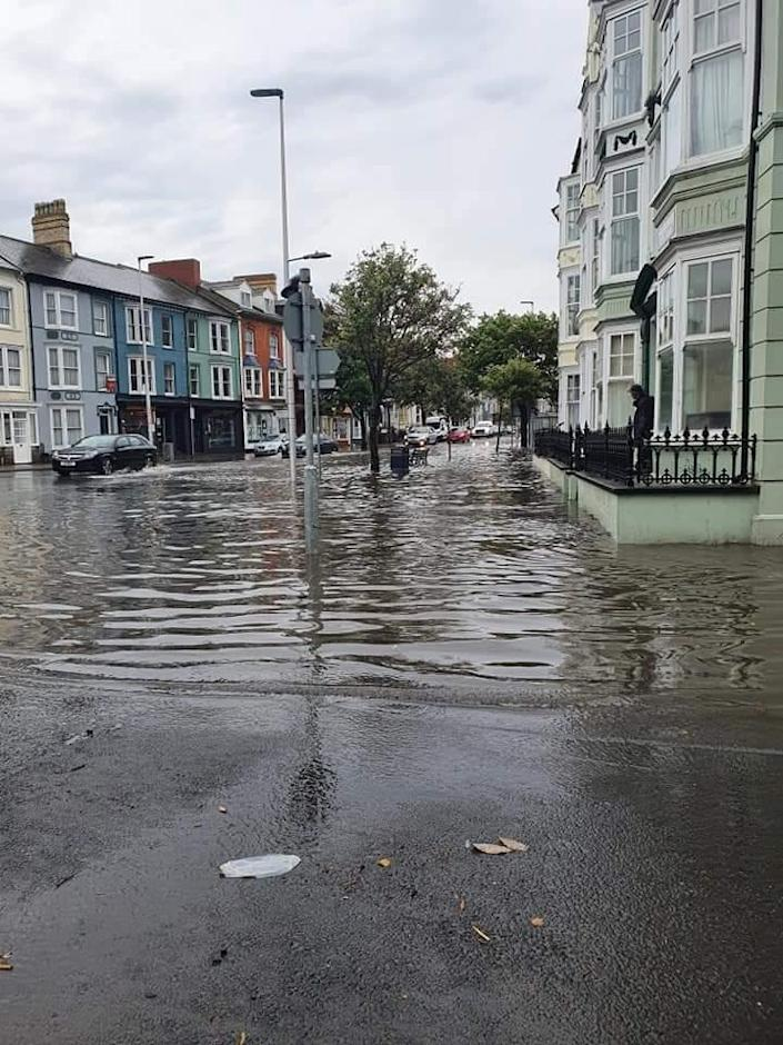 The streets of Aberystwyth in Wales were filled with floodwater. (Tom Kendall)