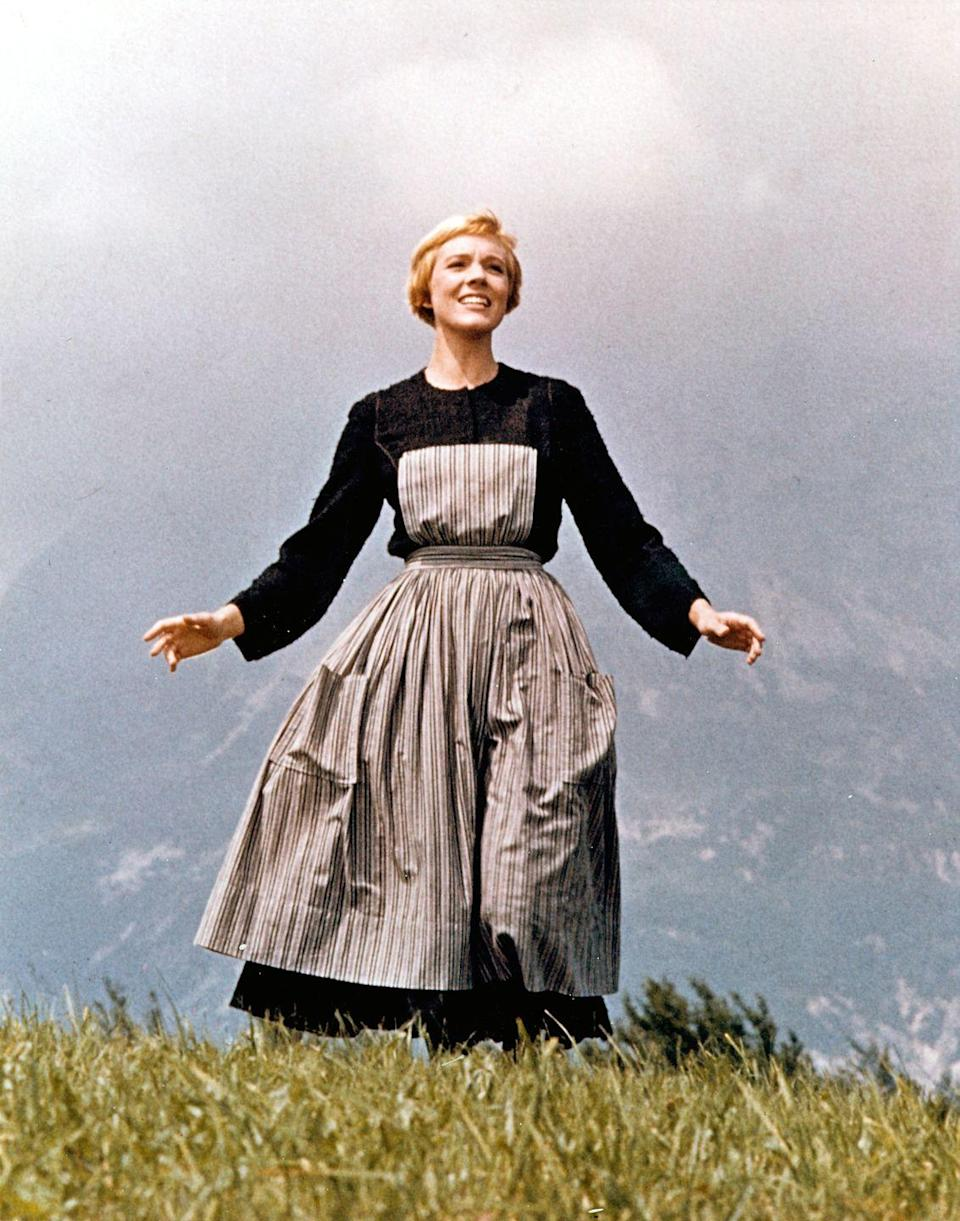 <p>Although Julie Andrews's character, Fräulein Maria, receives a well-deserved makeover in the second half of the movie, her simple long-sleeve dress and striped apron remains a true classic.</p>