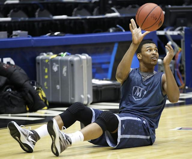 Mount St. Mary's forward Gregory Graves passes the ball during practice for an NCAA college basketball tournament game Monday, March 17, 2014, in Dayton, Ohio. Albany plays Mount St. Mary's on Tuesday in a first round game. (AP Photo/Al Behrman)
