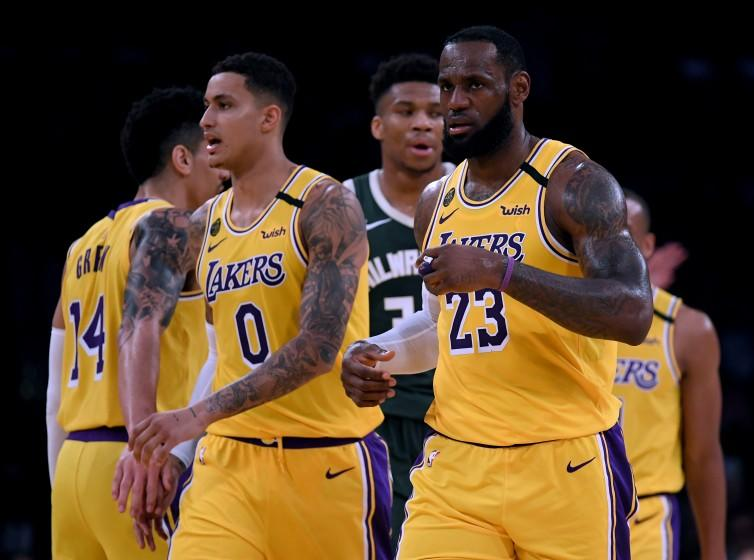 LOS ANGELES, CALIFORNIA - MARCH 06: LeBron James #23 and Kyle Kuzma #0 of the Los Angeles Lakers react after a James score, in front of Giannis Antetokounmpo #34 of the Milwaukee Bucks during a 113-103 Laker win at Staples Center on March 06, 2020 in Los Angeles, California. NOTE TO USER: User expressly acknowledges and agrees that, by downloading and or using this photograph, User is consenting to the terms and conditions of the Getty Images License Agreement. (Photo by Harry How/Getty Images)