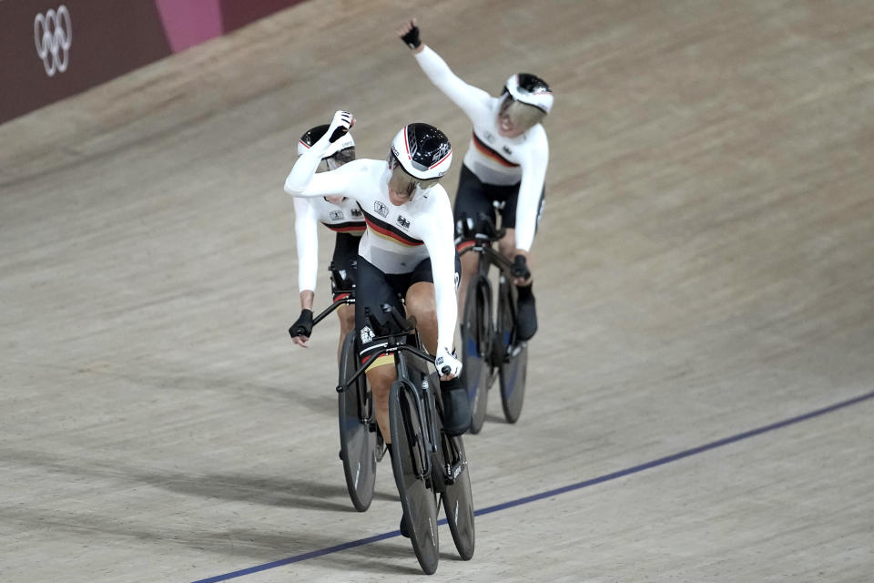 Team Germany celebrates during a qualifying heat for track cycling women's team pursuit at the 2020 Summer Olympics, Monday, Aug. 2, 2021, in Izu, Japan. (AP Photo/Christophe Ena)