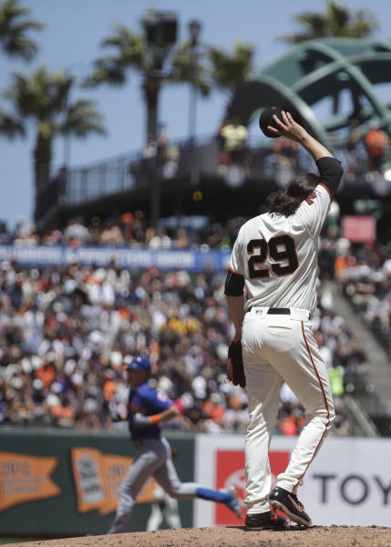 San Francisco Giants pitcher Jeff Samardzija (29) wipes his face as New York Mets' Jeff McNeil, left, runs the bases after hitting a two run home run in the fifth inning of a baseball game Saturday, July 20, 2019, in San Francisco. (AP Photo/Ben Margot)