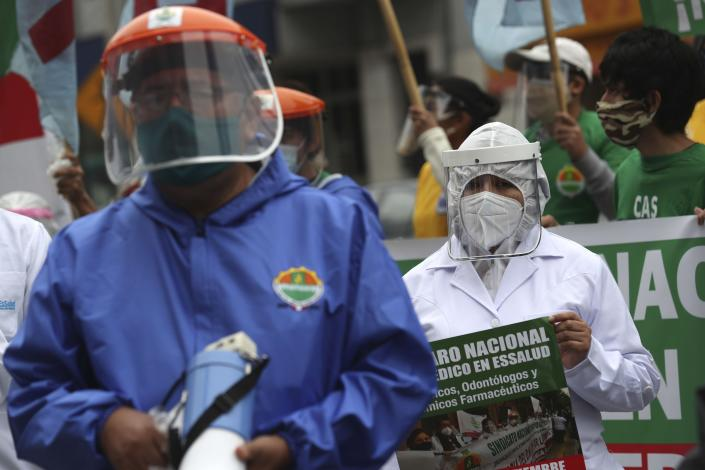 Health workers protest against the lack of protective equipment for those attending COVID-19 patients, outside a public hospital in Lima, Peru, Tuesday, Sept. 29, 2020. (AP Photo/Martin Mejia)