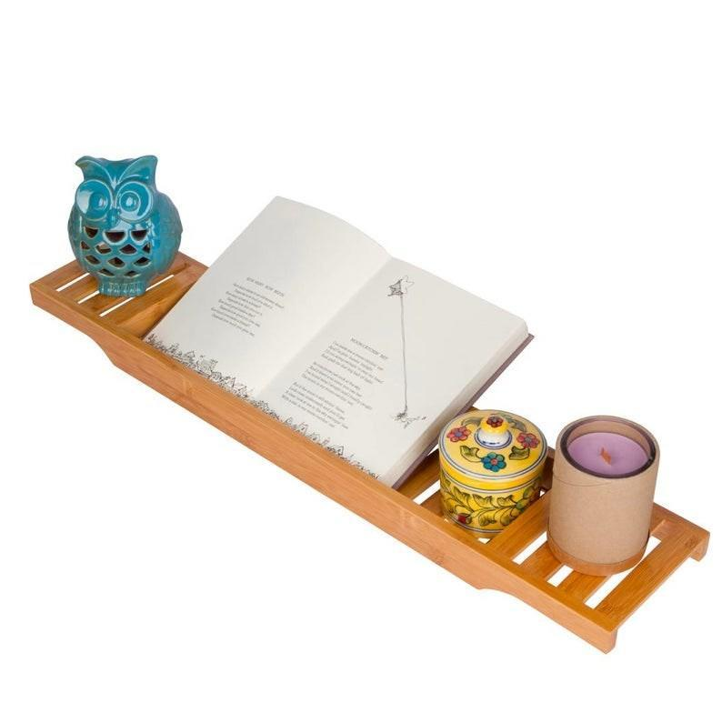 """Upgrade their self-care routine with this bamboo tray that will keep their must-have bath items within reach. $23, Home Depot. <a href=""""https://www.homedepot.com/p/Trademark-Innovations-Large-28-7-in-Bamboo-Long-Slatted-Bathtub-Tray-BAMB-TUBSLAT/303043086"""" rel=""""nofollow noopener"""" target=""""_blank"""" data-ylk=""""slk:Get it now!"""" class=""""link rapid-noclick-resp"""">Get it now!</a>"""