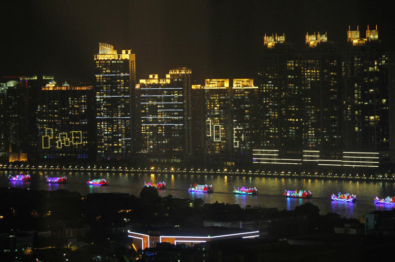 The boat parade sails down the Pearl River during the opening ceremony for the 16th Asian Games in Guangzhou, China, Friday, Nov. 12, 2010. (AP Photo/Vincent Yu)