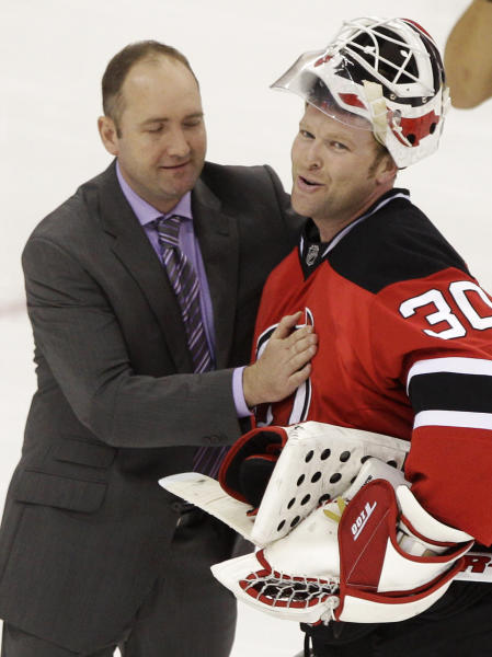 New Jersey Devils' Martin Brodeur greets coach Peter DeBoer after the Devils beat the New York Rangers 3-2 in overtime to win Game 6 of the NHL hockey Stanley Cup Eastern Conference finals Friday, May 25, 2012, in Newark, N.J. The Devils advanced to the Stanley Cup finals. (AP Photo/Frank Franklin II)
