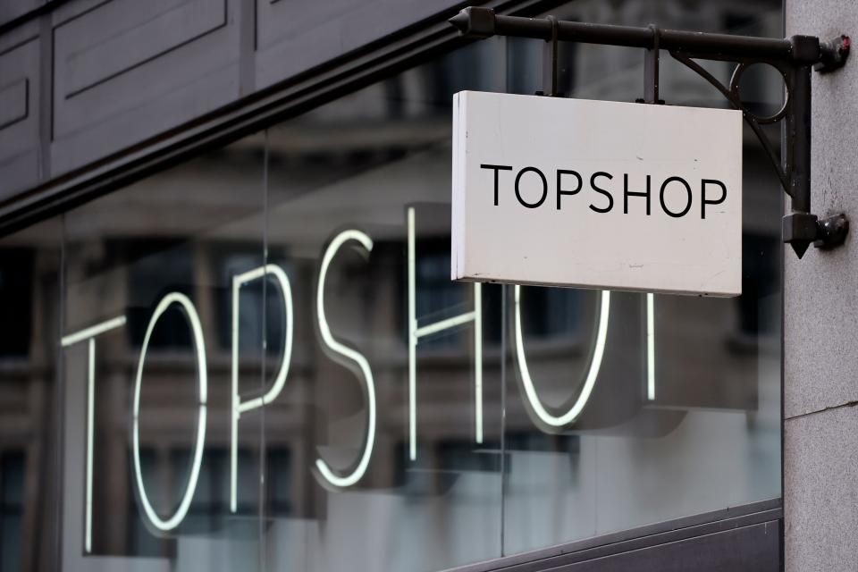 A sign is pictured outside a closed branch of the fashion retailer Topshop in central London on February 1, 2021. - Online clothing retailer ASOS bought Monday brands including Topshop from collapsed Arcadia but has snubbed its stores, resulting in around 2,500 job losses. (Photo by Tolga Akmen / AFP) (Photo by TOLGA AKMEN/AFP via Getty Images)