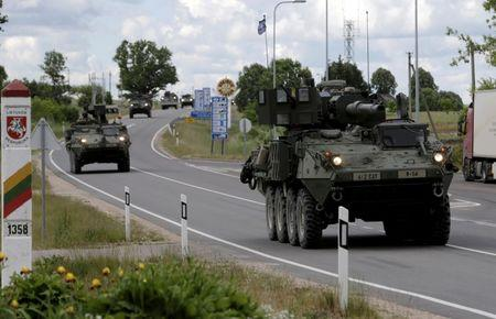 U.S. troops cross the Lithuanian-Latvian border during tactical road march Dragoon Ride II in Subate, Latvia, June 6, 2016. REUTERS/Ints Kalnins/File Photo