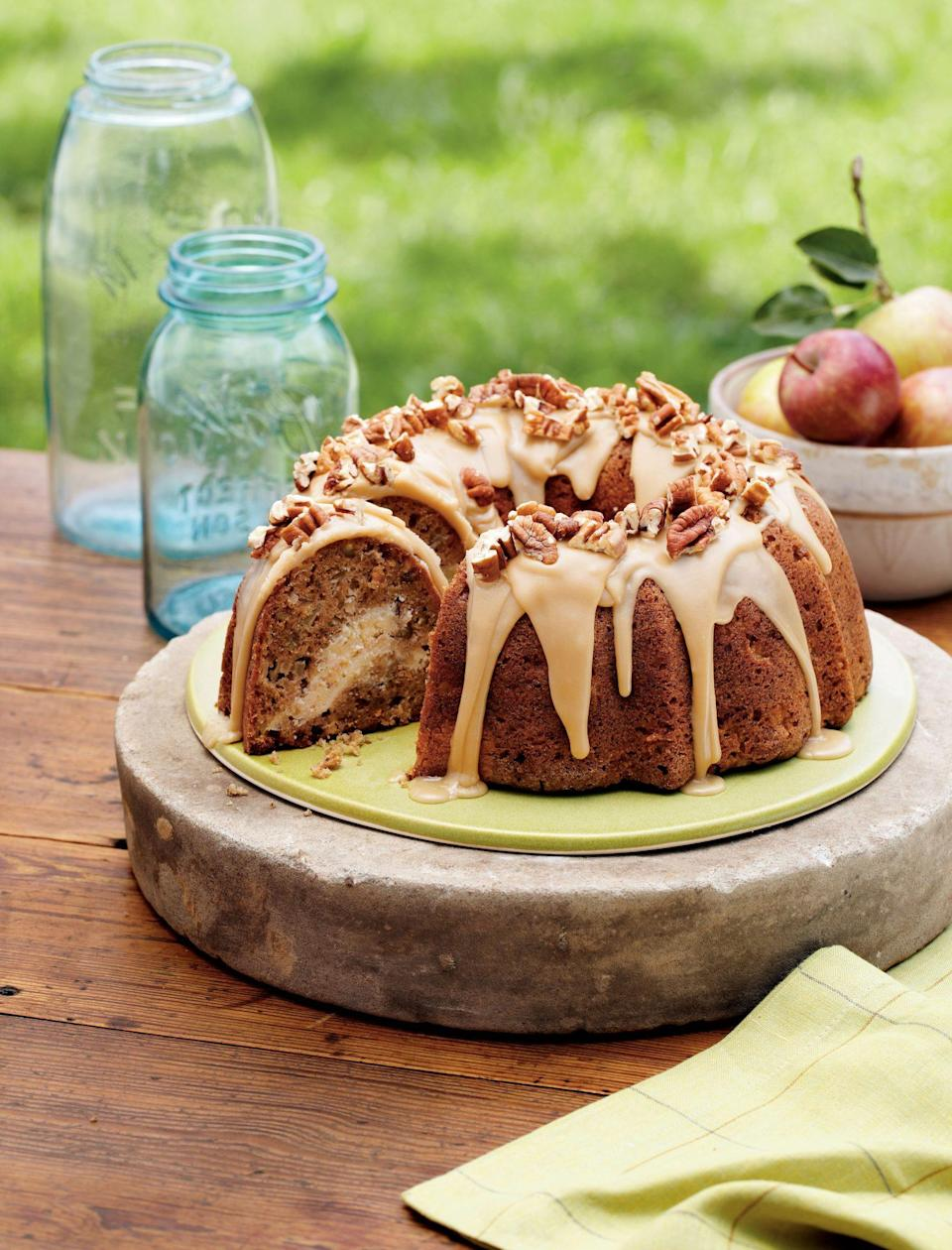 """<p><strong>Recipe: <a href=""""https://www.southernliving.com/syndication/apple-cream-cheese-bundt-cake"""" rel=""""nofollow noopener"""" target=""""_blank"""" data-ylk=""""slk:Apple-Cream Cheese Bundt Cake"""" class=""""link rapid-noclick-resp"""">Apple-Cream Cheese Bundt Cake</a></strong></p> <p>Your guests will be floored by the dreamy cream cheese tunnel when you cut into this pretty fall Bundt.</p>"""