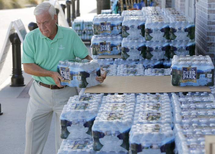 <p>Larry Pierson, from the Isle of Palms, S.C., purchases bottled water from the Harris Teeter grocery store on the Isle of Palms in preparation for Hurricane Florence at the Isle of Palms, S.C., Monday, Sept. 10, 2018. (Photo: Mic Smith/AP) </p>