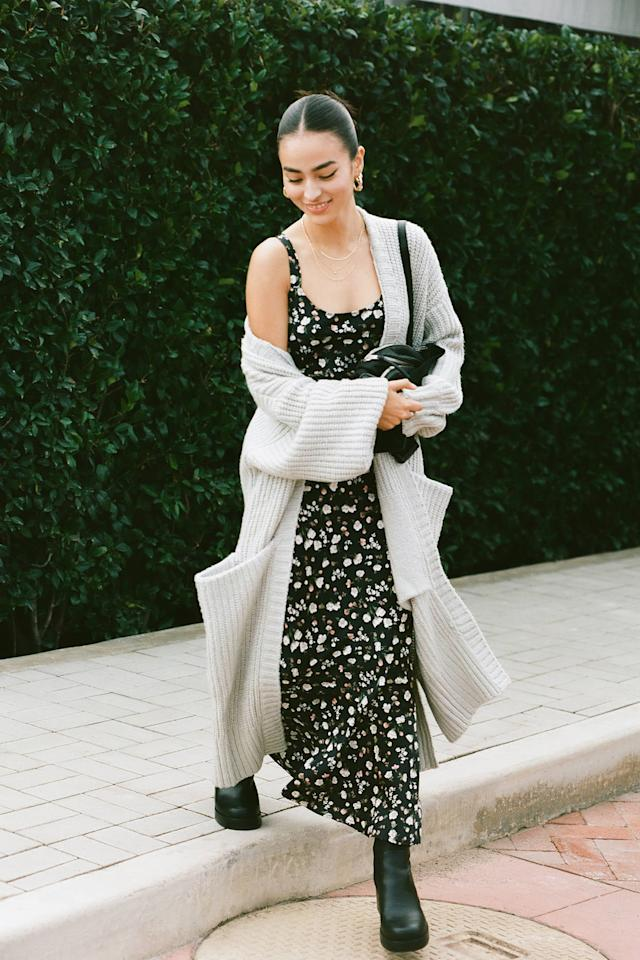 """<p>Go for a '90s look in this <a href=""""https://www.urbanoutfitters.com/shop/uo-andorra-ruffle-hem-slip-dress?category=womens-new-arrivals&amp;color=009&amp;quantity=1&amp;type=REGULAR"""" target=""""_blank"""" class=""""ga-track"""" data-ga-category=""""Related"""" data-ga-label=""""https://www.urbanoutfitters.com/shop/uo-andorra-ruffle-hem-slip-dress?category=womens-new-arrivals&amp;color=009&amp;quantity=1&amp;type=REGULAR"""" data-ga-action=""""In-Line Links"""">UO Andorra Ruffle Hem Slip Dress</a> ($79).</p>"""