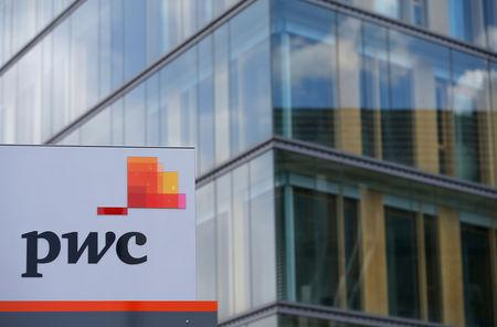 FILE PHOTO: The logo of PricewaterhouseCoopers is seen in front of the local offices building of the company in Luxembourg, April 26, 2016. REUTERS/Vincent Kessler