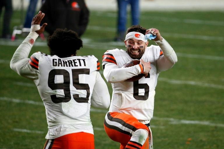 Cleveland quarterback Baker Mayfield and teammate Myles Garrett celebrate the Browns' NFL playoff victory over the Pittsburgh Steelers
