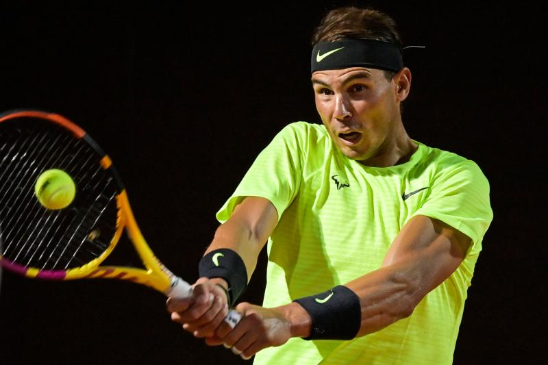 Spain's Rafael Nadal plays a backhand to Spain's Pablo Carreno Busta on day three of the Men's Italian Open at Foro Italico on September 16, 2020 in Rome, Italy. (Photo by Riccardo Antimiani / POOL / AFP) (Photo by RICCARDO ANTIMIANI/POOL/AFP via Getty Images)