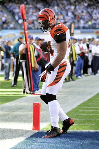 Cincinnati Bengals tight end Jermaine Gresham steps into the end zone for a touchdown against the San Diego Chargers during the first half of an NFL football game, Sunday, Dec. 2, 2012, in San Diego. (AP Photo/Denis Poroy)