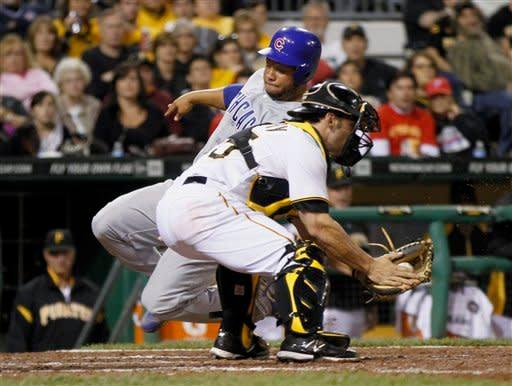 Chicago Cubs' Welington Castillo, top, slides behind Pittsburgh Pirates catcher Michael McKenry as he scores on a hit by David DeJesus in the eighth inning of a baseball game Saturday, Sept. 8, 2012, in Pittsburgh. (AP Photo/Keith Srakocic)