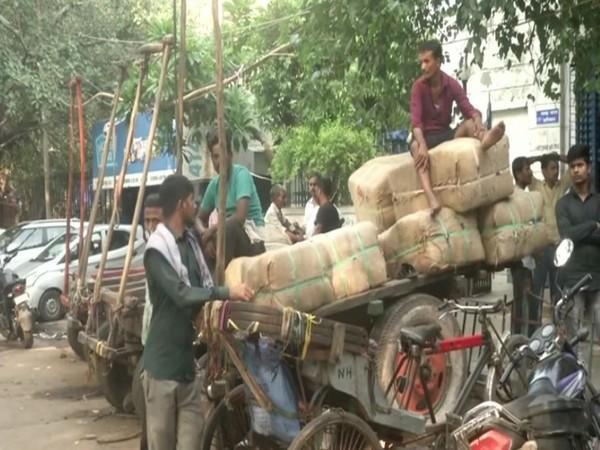 Cart pullers at Chandni chowk area. (Photo/ ANI)