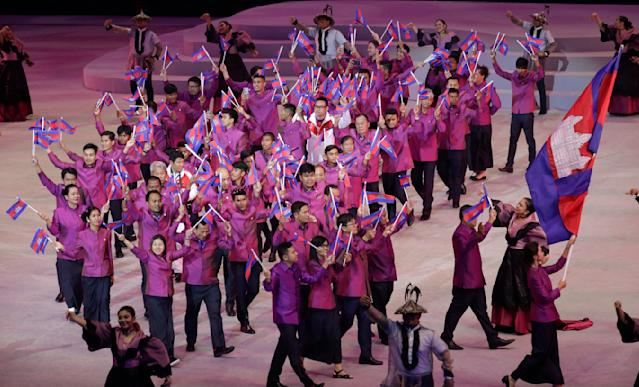Cambodia's team hold flags during the opening ceremony of the 30th South East Asian Games at the Philippine Arena, Bulacan province, northern Philippines on Saturday, Nov. 30, 2019. (AP Photo/Aaron Favila)