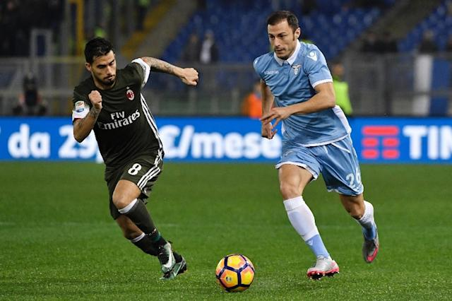 Lazio's defender from Romania Stefan Radu (R) vies for the ball with AC Milan's forward from Spain Fernandez Suso during the Italian Serie A football match Lazio vs Milan on February 13, 2017, at Rome's Olympic stadium (AFP Photo/ANDREAS SOLARO)