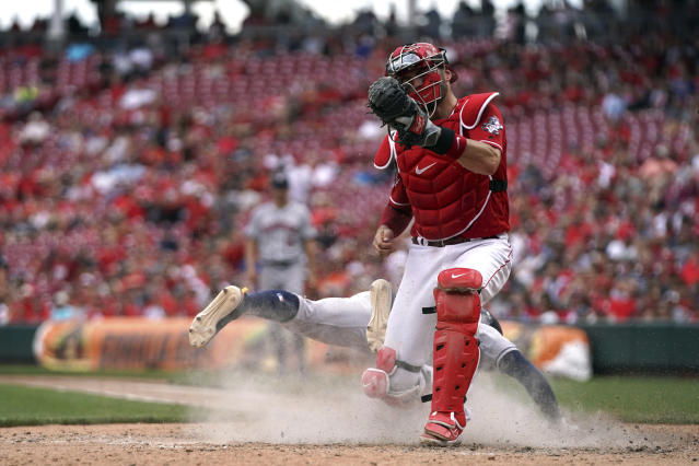 Houston Astros' Tony Kemp, back, is tagged out at home plate as he collides with Cincinnati Reds' Curt Casali in the eighth inning of a baseball game, Wednesday, June 19, 2019, in Cincinnati. The Reds won 3-2. (AP Photo/Aaron Doster)