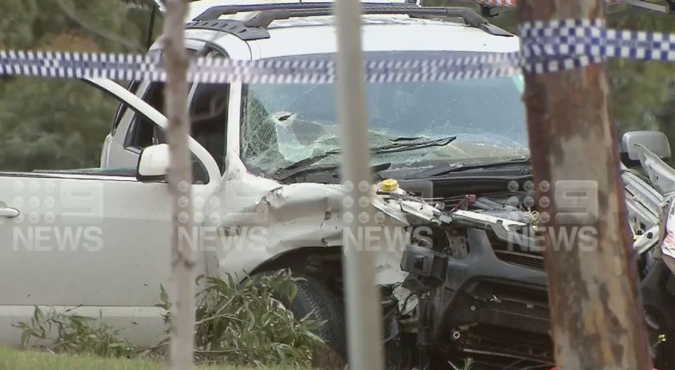 A smashed car with a bullet hole in the windshield on Princes Highway at Corio.