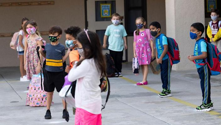Students keep their distance and wear masks during the first day of in-person classes at an elementary school in Rancho Santa Margarita, Calif. on Sept. 29, 2020.