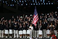 LONDON, ENGLAND - JULY 27: Mariel Zagunis of the United States Olympic fencing team carries her country's flag during the Opening Ceremony of the London 2012 Olympic Games at the Olympic Stadium on July 27, 2012 in London, England. (Photo by Alex Livesey/Getty Images)
